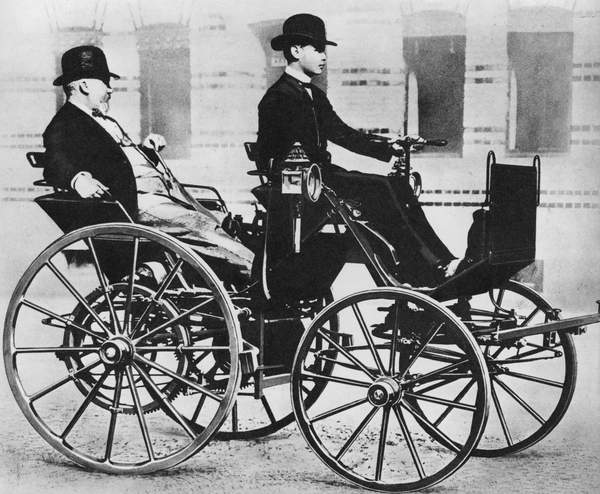 Gottlieb Daimler, with his son driving, in the first motor car, 1886 (bw photo), German Photographer (20th Century)  Private Collection  © Look and Learn  Bridgeman Images 5998019