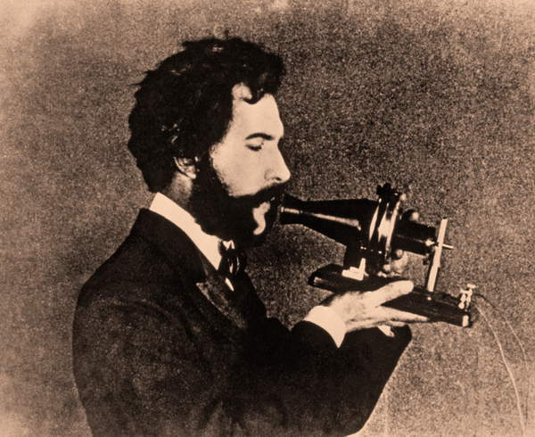 Portrait of Alexander Graham Bell speaking into a telephone receiver, c.1876 (photo)  Private Collection  Prismatic Pictures  Bridgeman Images  6425714