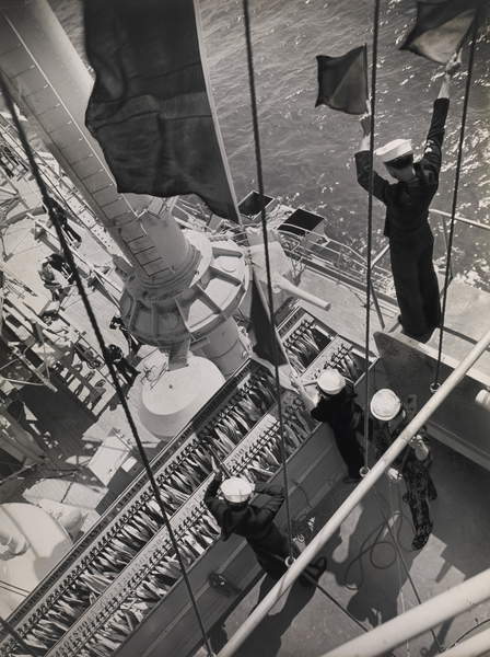 Navy Signalman using semaphore flags as he communicates with another ship  on board the USS Maryland, San Pedro, CA, 1939 (gelatin silver print), Bourke-White, Margaret © Museum of Fine Arts, Houston  Bridgeman Images