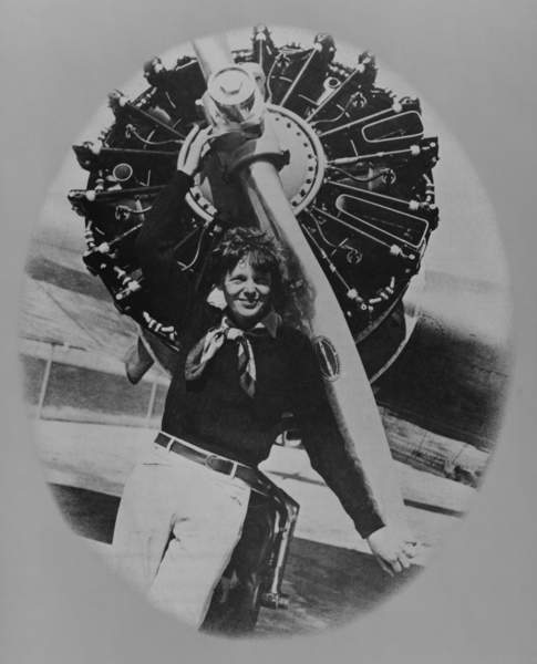 Asset - Amelia Earhart (1897-1937), posting in front of the propeller of her Lockheed L-10E Electra on July 8, 1937, on land during a stop in her final round-the-world flight which began from Miami, Florida, in June 1