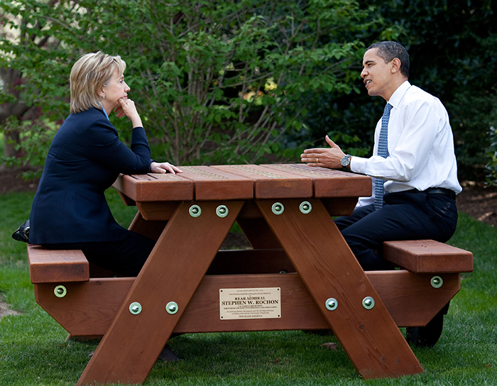 President Barack Obama and Secretary of State Hillary Rodham Clinton speak together sitting at a picnic table April 9, 2009, on the South Lawn of the White House